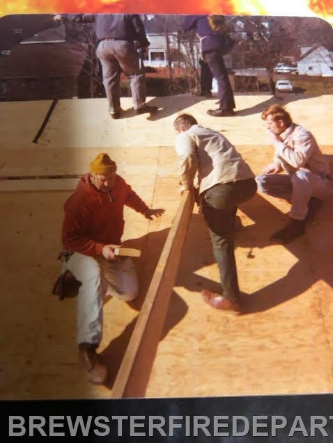 Photo #10 Bobby Hall on the right, among members working  on the roof.