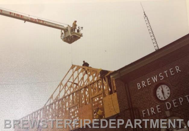Photo #11  Chief George Walsh lifting truss with Snorkel during 1964 addition.