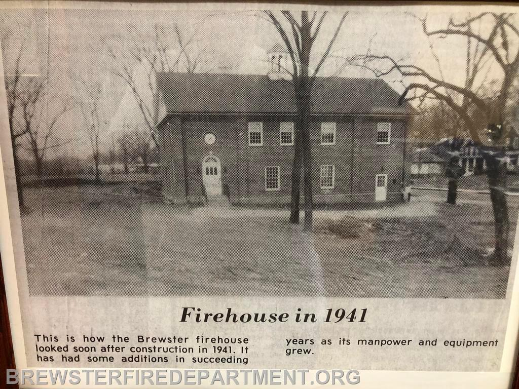 Photo #2 1941 Firehouse. North Main Street is to the right of the firehouse. The exit from the basement is in the back of this picture.