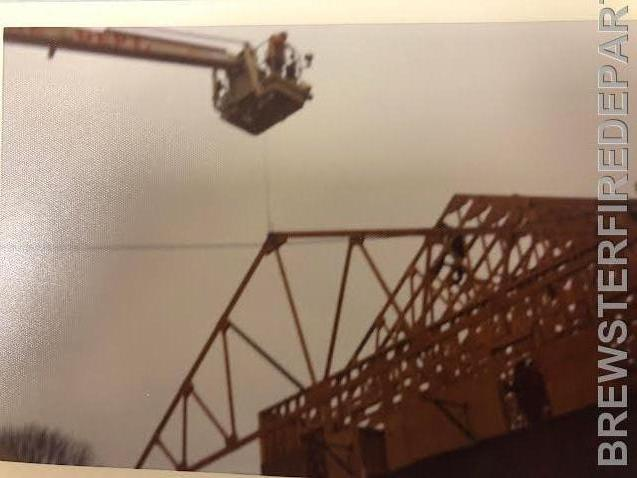 Photo #8  Truss being raised during the 1964 addition.